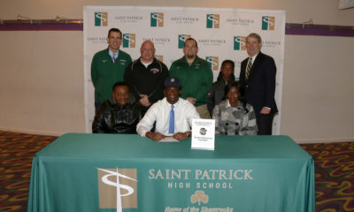 https://www.stpatrick.org/wp-content/uploads/2019/12/Kwame-Signing-for-Web-400x240.jpg